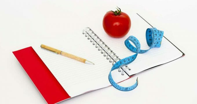 pen notebook and tomato